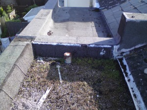 Existing failed flat roof system, approximate age 25 years, in need of immediate replacement.