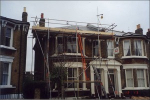 Frontal view of the property with scaffolding erected